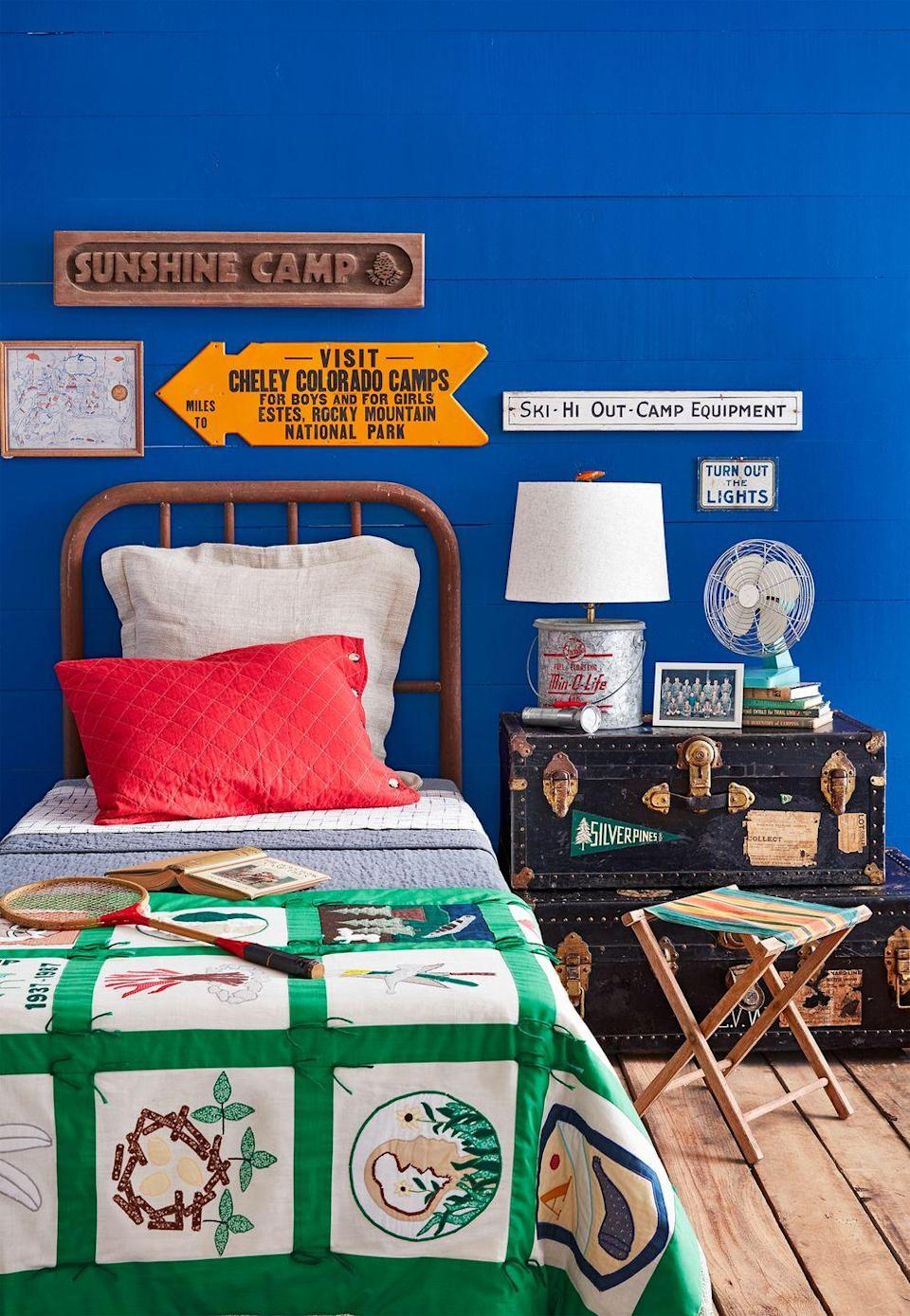 <p>Vintage camp signs become an instant focal point when they're hung on a bright wall. </p>