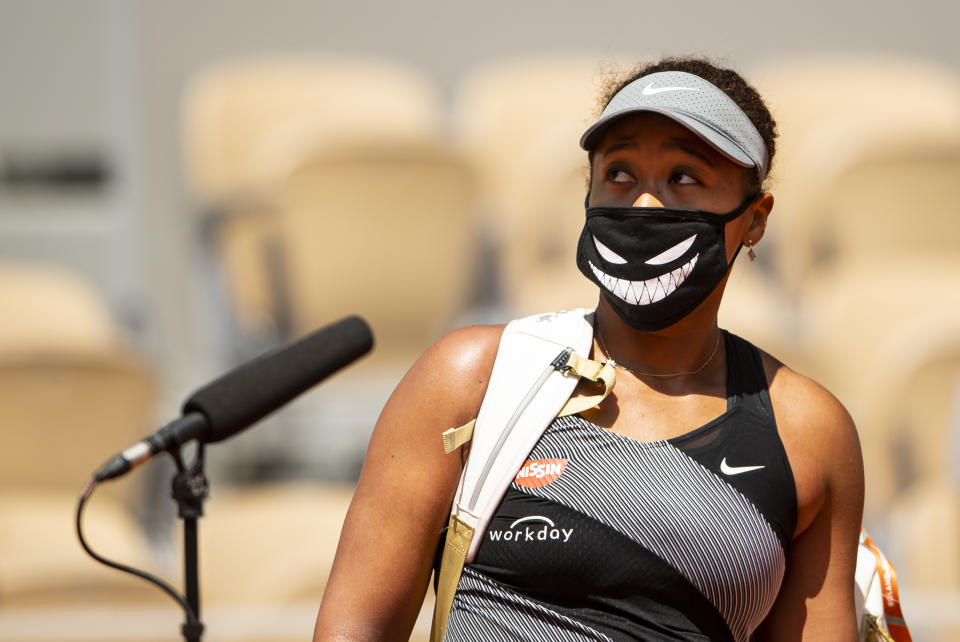 Naomi Osaka (pictured) is interviewed by Fabrice Santoro of France after her victory over Patricia Maria Țig of Romania in the first round of the women's singles at Roland Garros on May 30, 2021 in Paris, France.