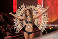 <p>Alessandra Ambrosio was the star of the show in 2011 in jewel-encrusted wings that cost an eye-watering amount. [Photo: Getty] </p>