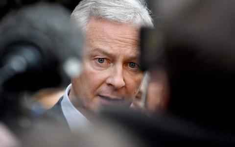French Finance and Economy Minister Bruno Le Maire visits a shopping area Rue Montorgueil in Paris on January 3, 2020 - Credit: ERIC PIERMONT/AFP