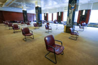 Amid the coronavirus pandemic, chairs are spaced for proper social distancing inside the jury room at a Manhattan federal courthouse, Friday, March 12, 2021, in New York. (AP Photo/Mary Altaffer)