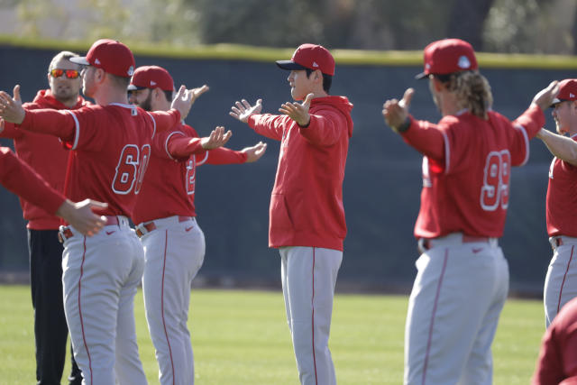Los Angeles Angels' Shohei Ohtani stretches with teammates during spring training baseball practice, Wednesday, Feb. 12, 2020, in Tempe, Ariz. (AP Photo/Darron Cummings)