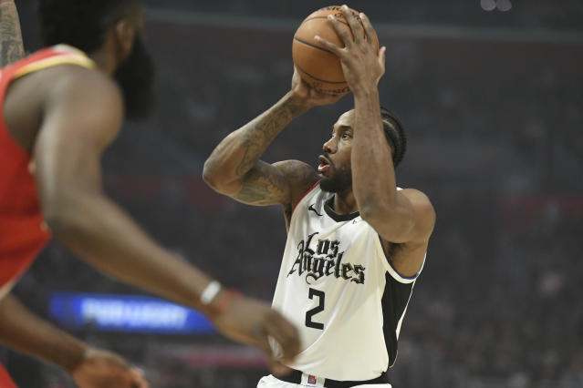 Los Angeles Clippers forward Kawhi Leonard shoots during the first half of the team's NBA basketball game against the Houston Rockets on Friday, Nov. 22, 2019, in Los Angeles. (AP Photo/Michael Owen Baker)