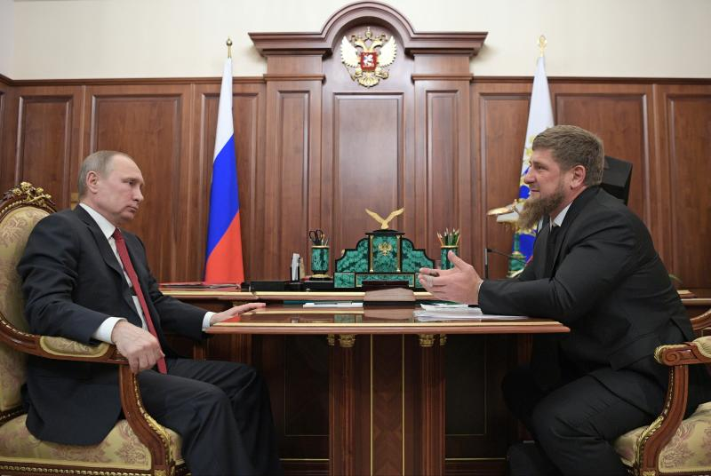 "In this photo taken Wednesday, April 19, 2017, Russian President Vladimir Putin, left, meets with Chechnya's regional leader Ramzan Kadyrov in the Kremlin in Moscow, Russia. Putin met late Wednesday with Kadyrov, who told the president not to believe the ""provocative"" articles, reporting detentions and killings of gay men in Chechnya, which he says have no basis in fact. (Alexei Druzhinin/Sputnik, Kremlin Pool Photo via AP)"