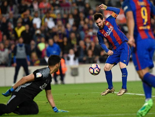 Barcelona's Lionel Messi scores a goal during a match against Real Sociedad in Barcelona on April 15, 2017 (AFP Photo/LLUIS GENE)