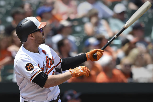Baltimore Orioles' Renato Nunez follows through on a two run home run against the Detroit Tigers in the first inning of a baseball game Monday, May 27, 2019, in Baltimore. (AP Photo/Gail Burton)