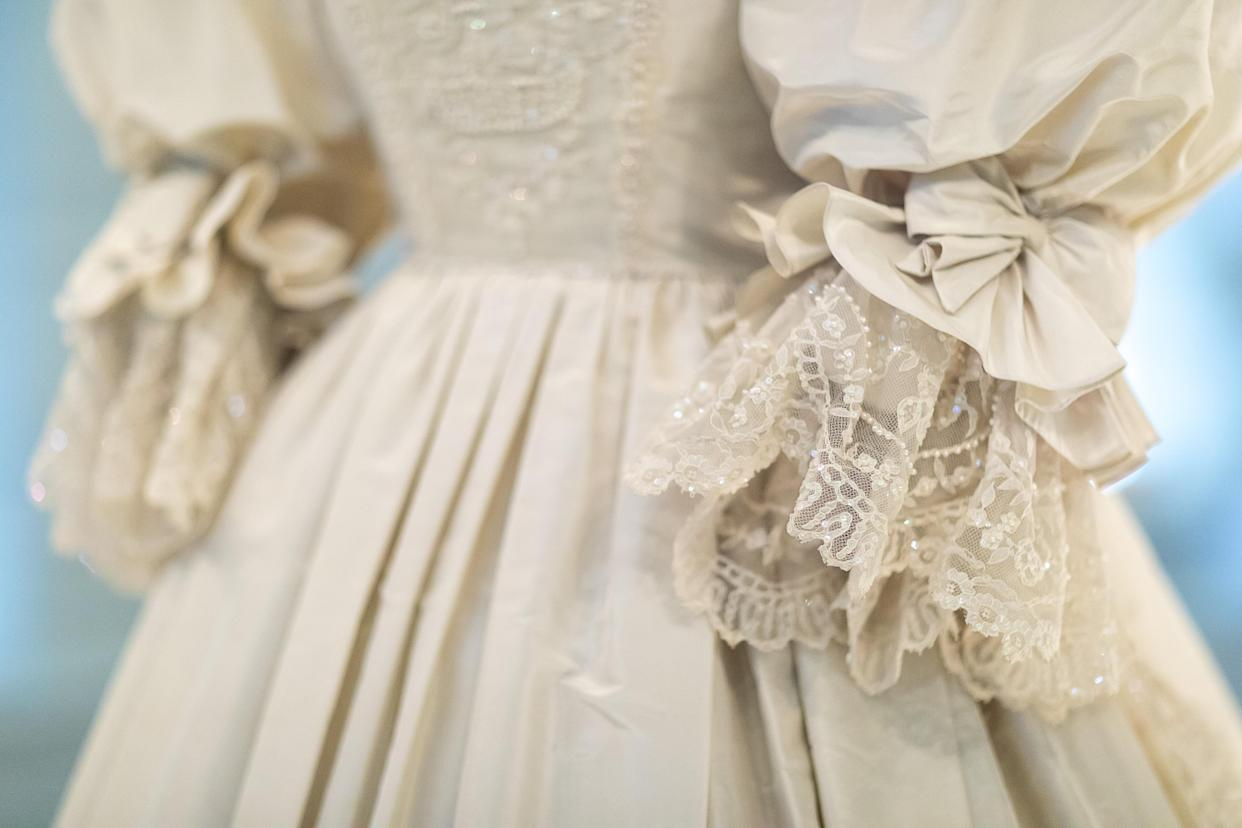 LONDON, ENGLAND - JUNE 02: Detail of Diana, Princess of Wales's wedding dress displayed complete with its spectacular sequin encrusted train during the