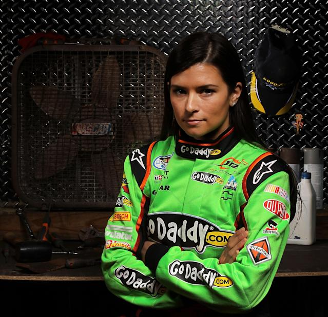 DAYTONA BEACH, FL - FEBRUARY 16: Danica Patrick, driver of the #7 GoDaddy.com Chevrolet, poses during NASCAR Media Day at Daytona International Speedway on February 16, 2012 in Daytona Beach, Florida. (Photo by Jamie Squire/Getty Images for NASCAR)