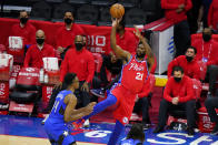 Philadelphia 76ers' Joel Embiid, right, goes up for a shot against Orlando Magic's Wendell Carter Jr. during the second half of an NBA basketball game, Friday, May 14, 2021, in Philadelphia. (AP Photo/Matt Slocum)
