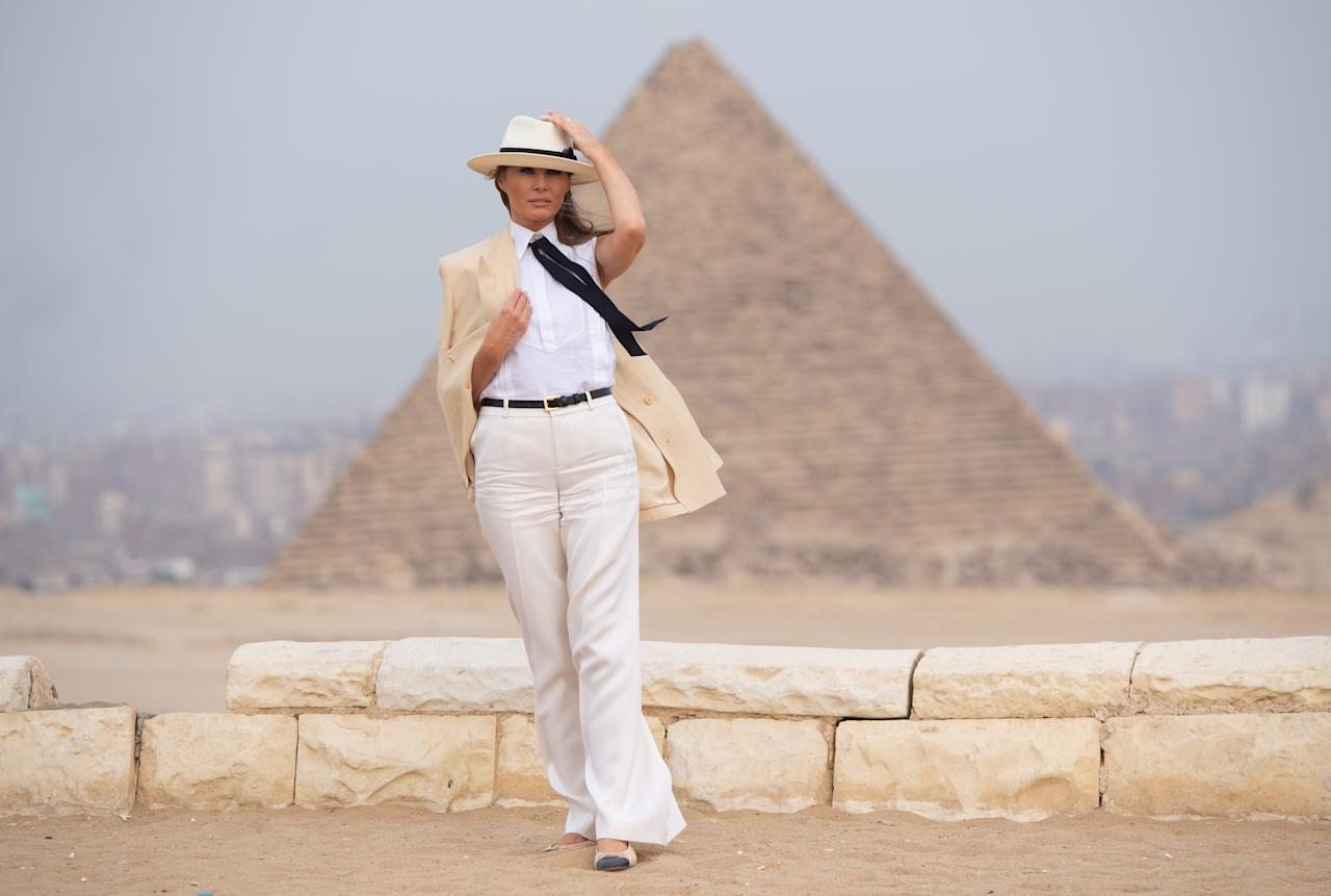 <p>The outfit Melania wore to visit the Giza Pyramids in Egypt raised eyebrows globally. Donning a cream linen blazer, matching wide-legged trousers, a white shirt, black tie and Chanel ballerina pumps, the FLOTUS's look drew many comparisons. Some compared the look to Michael Jackson's Smooth Criminal loko, quipping 'Hey Melania, are you OK?'. Others wondered if it was an attempt at a feminist statement. <em>[Photo: Getty]</em> </p>