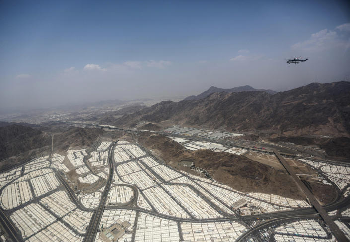 FILE - In this Sept. 25 2015 file photo, tents for pilgrims attending the annual hajj pilgrimage are seen from a helicopter over Mina, Saudi Arabia. On the second day of the hajj, after spending the night in the massive valley of Mina, the pilgrims head to Mount Arafat, some 20 kilometers (12 miles) east of Mecca, for the pinnacle of the pilgrimage. (AP Photo/Mosa'ab Elshamy, File)