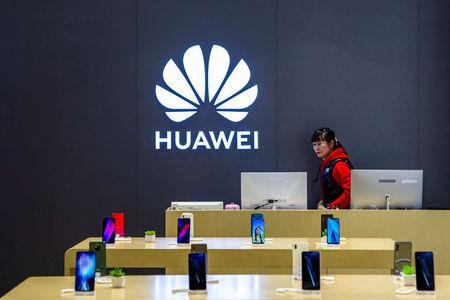 FILE PHOTO: Staff member is seen inside a Huawei retail store in Shanghai