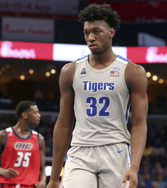 Memphis James Wiseman (32) take his position on the floor between plays iduring the second half of an NCAA college basketball game against Illinois-Central Friday, Nov. 8, 2019, in Memphis, Tenn. (AP Photo/Karen Pulfer Focht)