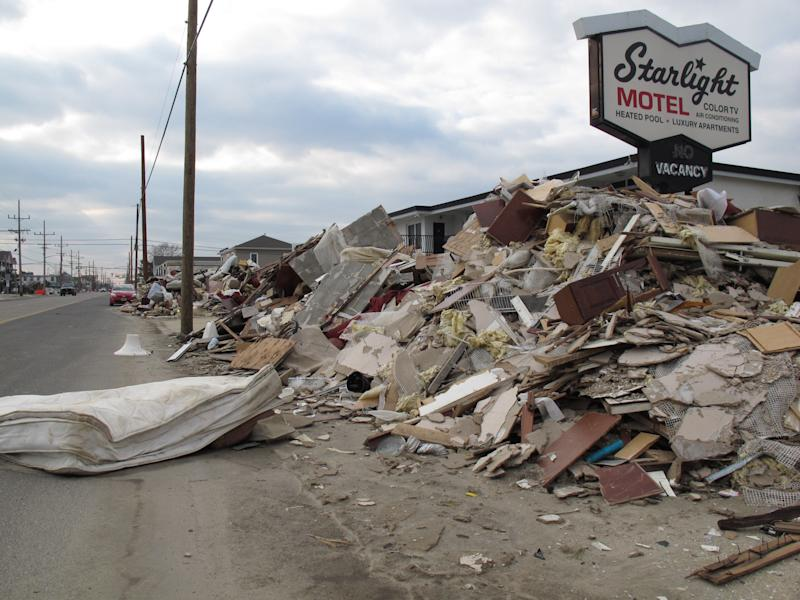 At a glance: 3 months later, Sandy losses mount