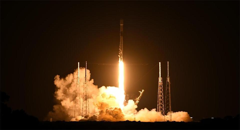 A SpaceX Falcon 9 rocket carrying 60 Starlink internet satellites climbs away from the Cape Canaveral Space Force Station early Sunday, using a first stage making a record tenth flight. / Credit: William Harwood/CBS News