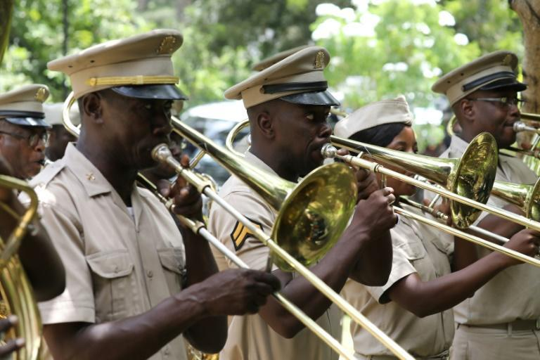 Musicians play the National Anthem during the ceremony for late Haitian president Jovenel Moise