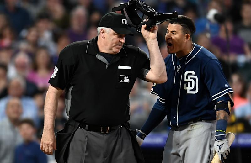 MLB home plate umpire Bill Welke (3) ejects and San Diego Padres shortstop Manny Machado (13) during the fifth inning against the Colorado Rockies at Coors Field. (Ron Chenoy-USA TODAY Sports)