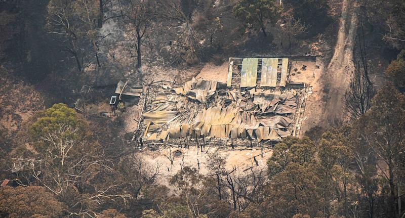Australian prime minister is jeered in wildfire-ravaged zone