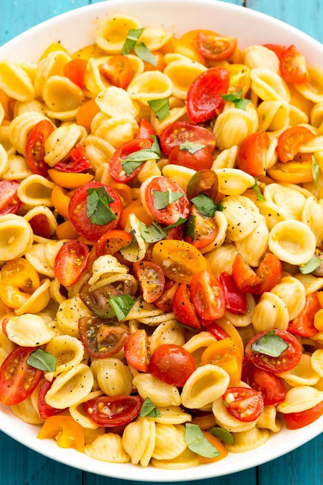 """<p>Perfect in its simplicity: Cherry tomatoes, lots of garlic, and basil. </p><p>Get the recipe from <a rel=""""nofollow"""" href=""""https://www.delish.com/cooking/recipe-ideas/recipes/a47335/bruschetta-pasta-salad-recipe/"""">Delish</a>.</p>"""