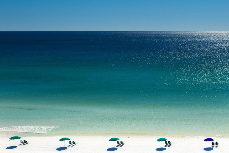 <p>Florida's Emerald Coast is peppered with charming beach towns, with Destin being one of the most famous. Sugary white sands and jewel-toned waters define the beaches here, and its known for world-class fishing, golf, and amenity-rich resorts when you need a break from sunbathing. </p>
