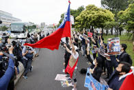 Myanmarese residents in Japan and supporters protest against the military takeover, outside the Fukuda Denshi Arena where the Asian qualification soccer match between Myanmar and Japan for the FIFA World Cup Qatar 2022 is held, in Chiba, east of Tokyo, Friday, May 28, 2021.(Kyodo News via AP)