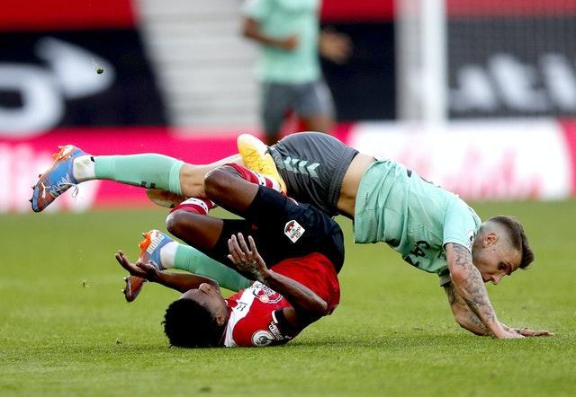 Lucas Digne (top) was dismissed for his tackle on Kyle Walker-Peters.