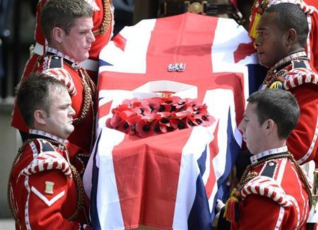The coffin of Fusilier Lee Rigby is carried by members of his regiment after his funeral service at the parish church in Bury,