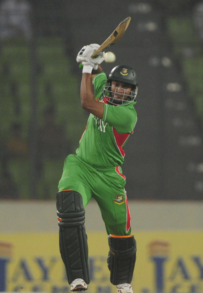 Bangladeshi batsman Shakib Al Hasan plays a shot during the one day international (ODI) Asia Cup cricket match between Bangladesh and Pakistan at The Sher-e-Bangla National Cricket Stadium in Dhaka on March 11, 2012. AFP PHOTO/Munir uz ZAMAN (Photo credit should read MUNIR UZ ZAMAN/AFP/Getty Images)