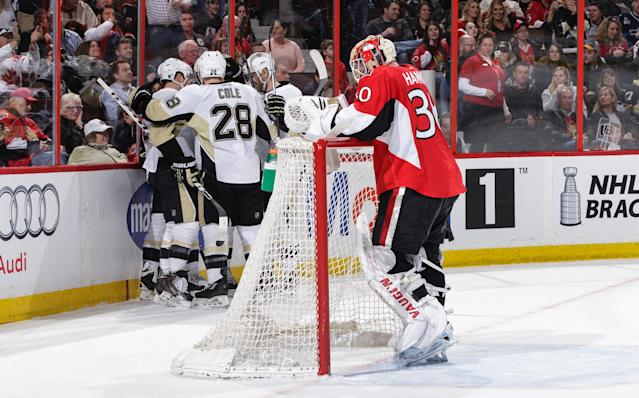 OTTAWA, ON - APRIL 5: Ian Cole #28 of the Pittsburgh Penguins celebrates a third period goal scored by Carl Hagelin (not shown) as Andrew Hammond #30 of the Ottawa Senators reacts at the net the at Canadian Tire Centre on April 5, 2016 in Ottawa, Ontario, Canada. (Photo by Jana Chytilova/Freestyle Photography/Getty Images)
