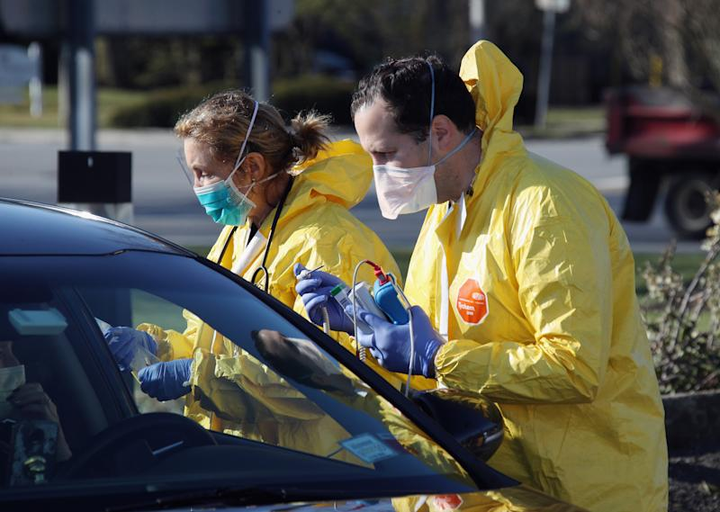 JERICHO, NEW YORK - MARCH 18: Health care workers tend to patients at the drive-in center at ProHealth Care on March 18, 2020 in Jericho, New York. The facility offers COVID-19 testing as more than 200,000 people in at least 144 countries have been infected, with deaths in the U.S. surpassing 100. The World Health Organization declared COVID-19 a global pandemic on March 11. (Photo by Bruce Bennett/Getty Images)