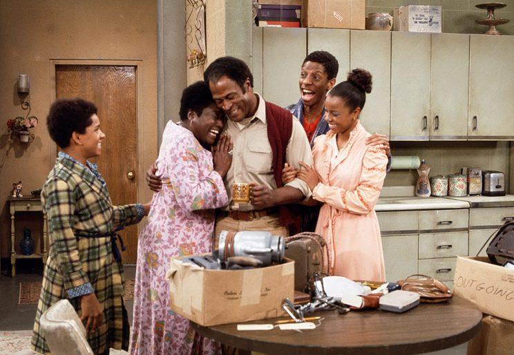 Ralph Carter as Michael Evans, Esther Rolle as Florida Evans, John Amos as James Evans, Jimmie Walker as J.J. Evans, and BernNadette Stanis as Thelma Evans in Good Times. (Photo by CBS Photo Archive/Getty Images)