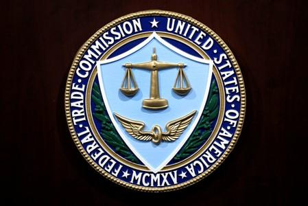 Federal Trade Commission seal is seen at a news conference at FTC headquarters in Washington