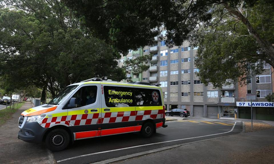 A NSW ambulance is seen departing a housing tower in Redfern on Thursday.