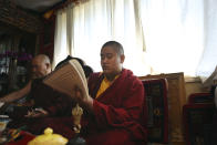 Jalue Dorje, recognized as the eighth reincarnation of the lama Terchen Taksham Rinpoche, recites prayers during a ceremony paying homage to Guru Rinpoche, the Indian Buddhist master who brought Tantric Buddhism to Tibet, on Monday, July 19, 2021, in Columbia Heights, Minn. . After finishing high school in 2025, Jalue will head to northern India and join the Mindrolling Monastery, more than 7,200 miles (11,500 kilometers) from his home. (AP Photo/Jessie Wardarski)