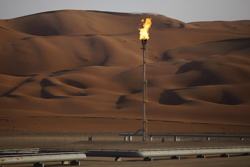 Oil drops 3 pct, pares OPEC gains on stock market weakness