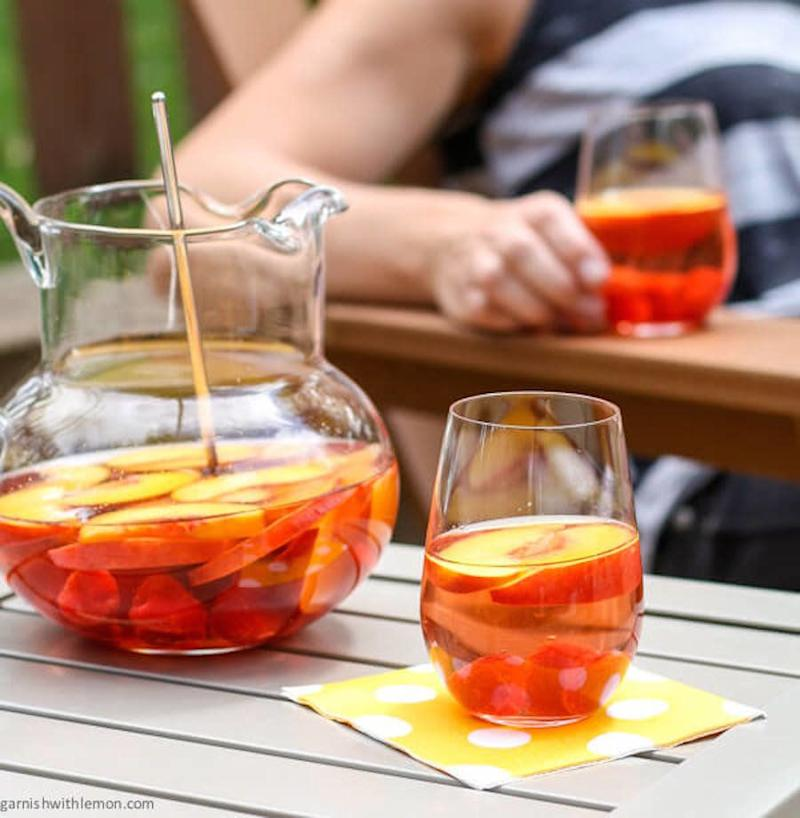 "<strong>Get the <a href=""http://www.garnishwithlemon.com/peach-rose-sangria/"" target=""_blank"">Peach Rosé Sangria recipe </a>from Garnish With Lemon</strong>"