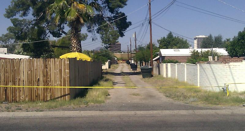 An alley path behind the street where a 6-year-old Tucson girl went missing from her home is cut off with police tape in Tucson, Ariz., Sunday, April 22, 2012. Police cordoned off a neighborhood block where Isabel Mercedes Celis went missing from her home during the night, as authorities fanned out Sunday over a wide area looking for clues to the possible kidnapping. (AP Photo/Terry Tang)