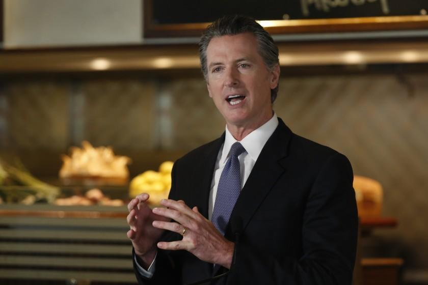 Newsom defends California reopening rules even as coronavirus cases rise