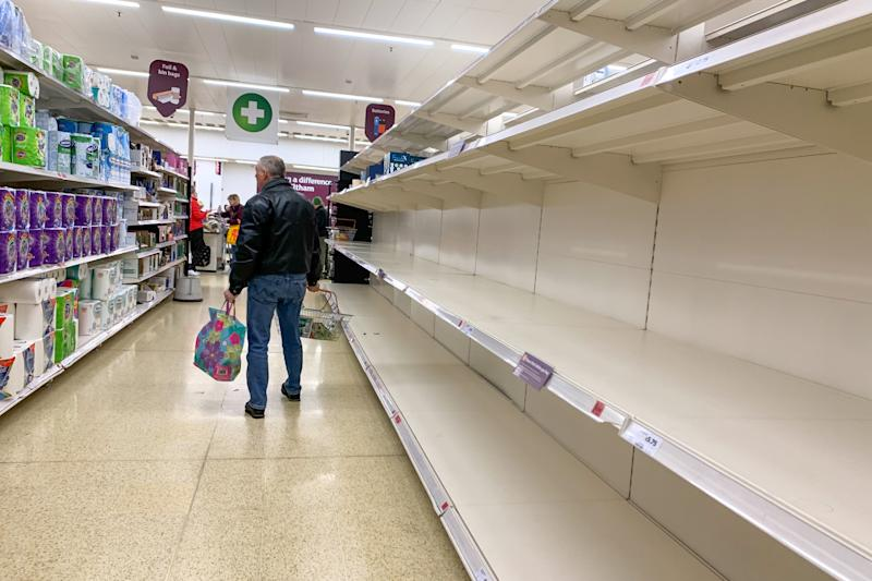 Empty shelves in a store in London as shoppers stockpile basic consumer goods for fears of a potential quarantine due to an outbreak of Coronavirus (COVID-19) on March 16, 2020 in London, UK. (Photo by Robin Pope/NurPhoto via Getty Images)