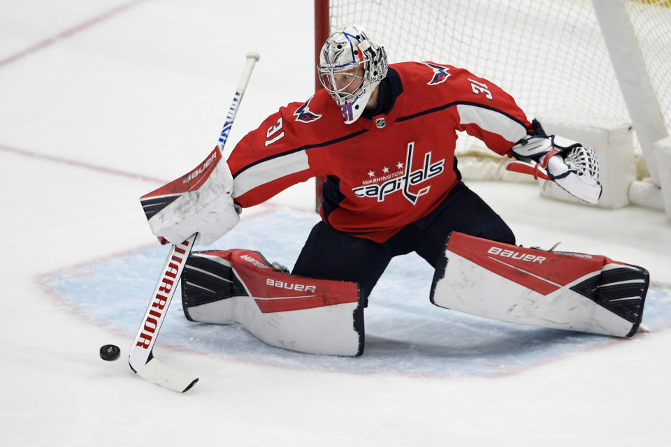 Washington Capitals goaltender Craig Anderson reaches for the puck during the first period of the team's NHL hockey game against the Philadelphia Flyers, Saturday, May 8, 2021, in Washington. (AP Photo/Nick Wass)