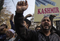 Activists of Peoples Democratic party (PDP) protesting against India's new land laws that allows any Indian citizen to buy land in the disputed region shout slogans in Srinagar, Indian controlled Kashmir, Thursday, Oct. 29, 2020. Until last year, Indians were not allowed to buy property in the region. But in August 2019, Prime Minister Narendra Modi's government scrapped the disputed region's special status, annulled its separate constitution, split the region into two federal territories. (AP Photo/Mukhtar Khan)