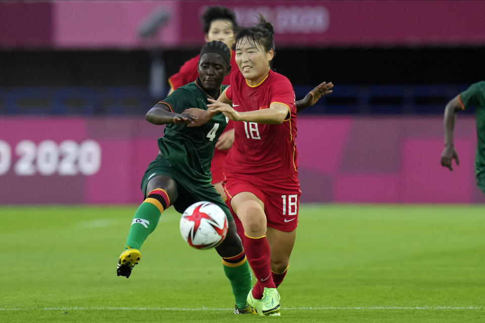 China's Wurigumula (18) and Zambia's Esther Siamfuko (4) battle for the ball during a women's soccer match at the 2020 Summer Olympics, Saturday, July 24, 2021, in Miyagi, Japan. (AP Photo/Andre Penner)