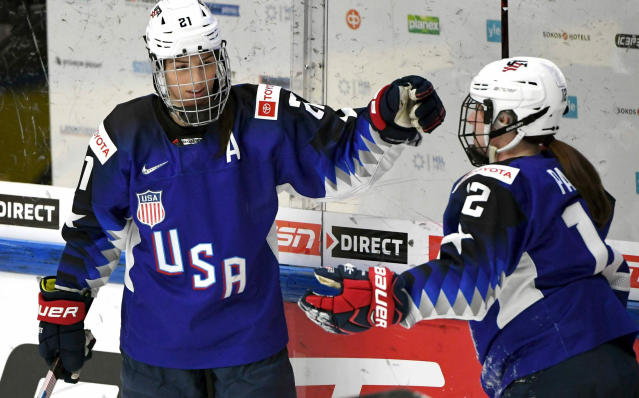 FILE - In this April 13, 2019, file photo, Team USA's Hilary Knight, left, celebrates a goal with Kelly Pannek, who provided the assist, during a IIHF Women's Ice Hockey World Championships semifinal match against Russia, in Espoo, Finland. More than 200 of the top female hockey players in the world have decided they will not play professionally in North America next season, hoping their stand leads to a single economically sustainable league. The announcement Thursday, May 2, 2019, comes after the Canadian Women's Hockey League abruptly shut down as of Wednesday, leaving the five-team, U.S.-based National Women's Hockey League as the only pro league in North America. The group of players, led by American stars Hilary Knight and Kendall Coyne Schofield and Canadian goaltender Shannon Szabados, hopes their move eventually pushes the NHL to start its own women's hockey league as the NBA did with the WNBA. (Jussi Nukari/Lehtikuva via AP, File)