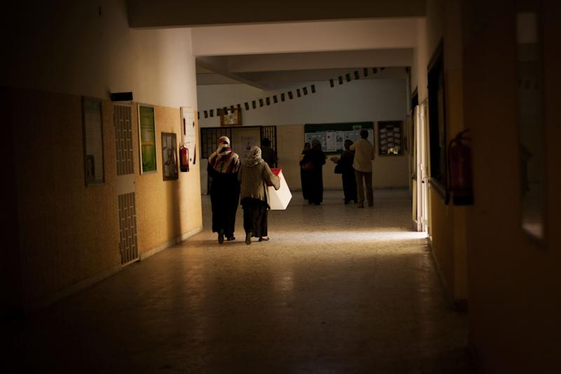 Libyan women work at a polling station in Tripoli, Libya, Friday, July 6, 2012. The Libyan National Assembly elections will take place on July 7, 2012 and will be the first free elections since 1969. (AP Photo/Manu Brabo)