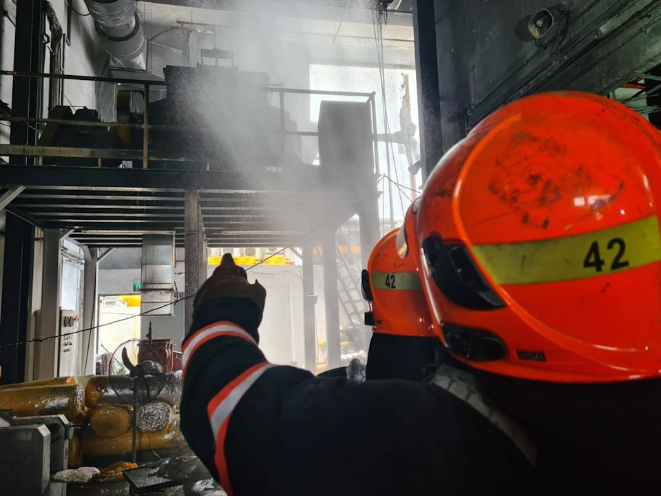 SCDF officers putting out the fire at the unit in the Platinum@Pioneer building on 24 February 2021. (PHOTO: Singapore Civil Defence Force Facebook page)