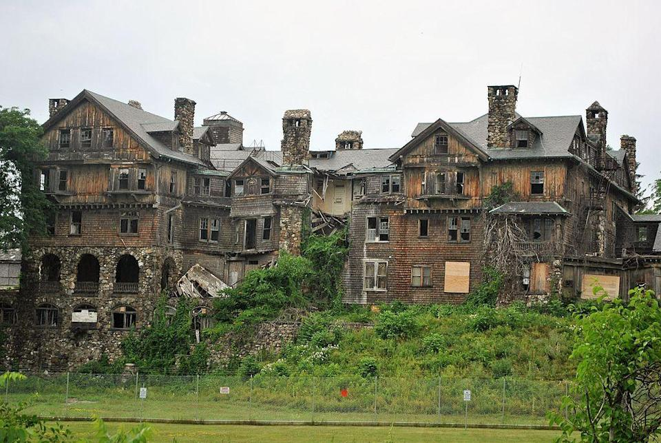 """<p>Built as a luxury hotel in 1893, this 200-room structure became the main building of Bennett College in 1907. The women's college closed in 1978 after going bankrupt. The property was <a href=""""https://www.poughkeepsiejournal.com/story/money/2014/05/13/bennett-college-lands-bought/9036929/"""" rel=""""nofollow noopener"""" target=""""_blank"""" data-ylk=""""slk:purchased in 2014"""" class=""""link rapid-noclick-resp"""">purchased in 2014</a>, and the new owners planned to tear down Halcyon Hall and turn part of the 27.5-acre site into a park. As of August 2016, however, the <a href=""""http://www.themillbrookindependent.com/content/bennett-college-not-coming-down-any-time-soon"""" rel=""""nofollow noopener"""" target=""""_blank"""" data-ylk=""""slk:dilapidated building was still standing"""" class=""""link rapid-noclick-resp"""">dilapidated building was still standing</a>.</p>"""