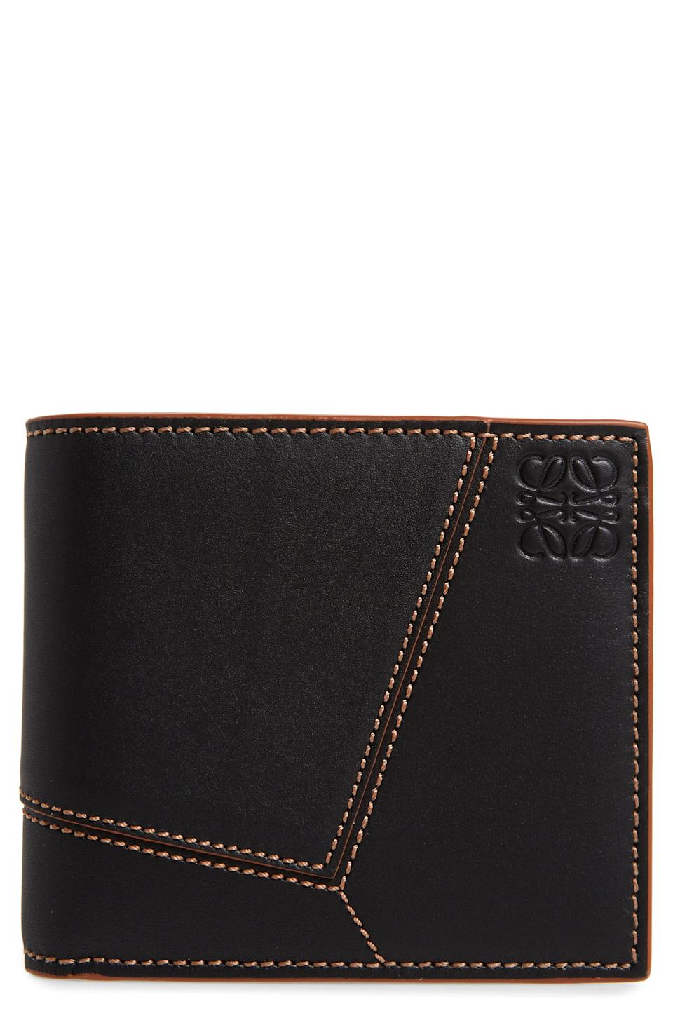 """<p><strong>Loewe</strong></p><p>nordstrom.com</p><p><strong>$550.00</strong></p><p><a href=""""https://go.redirectingat.com?id=74968X1596630&url=https%3A%2F%2Fwww.nordstrom.com%2Fs%2Floewe-puzzle-stitch-leather-bifold-wallet%2F5685833&sref=https%3A%2F%2Fwww.esquire.com%2Fstyle%2Fmens-accessories%2Fg35924710%2Fmens-luxury-wallets%2F"""" rel=""""nofollow noopener"""" target=""""_blank"""" data-ylk=""""slk:Shop Now"""" class=""""link rapid-noclick-resp"""">Shop Now</a></p><p>A luxury wallet for the arts-and-crafts set.</p>"""