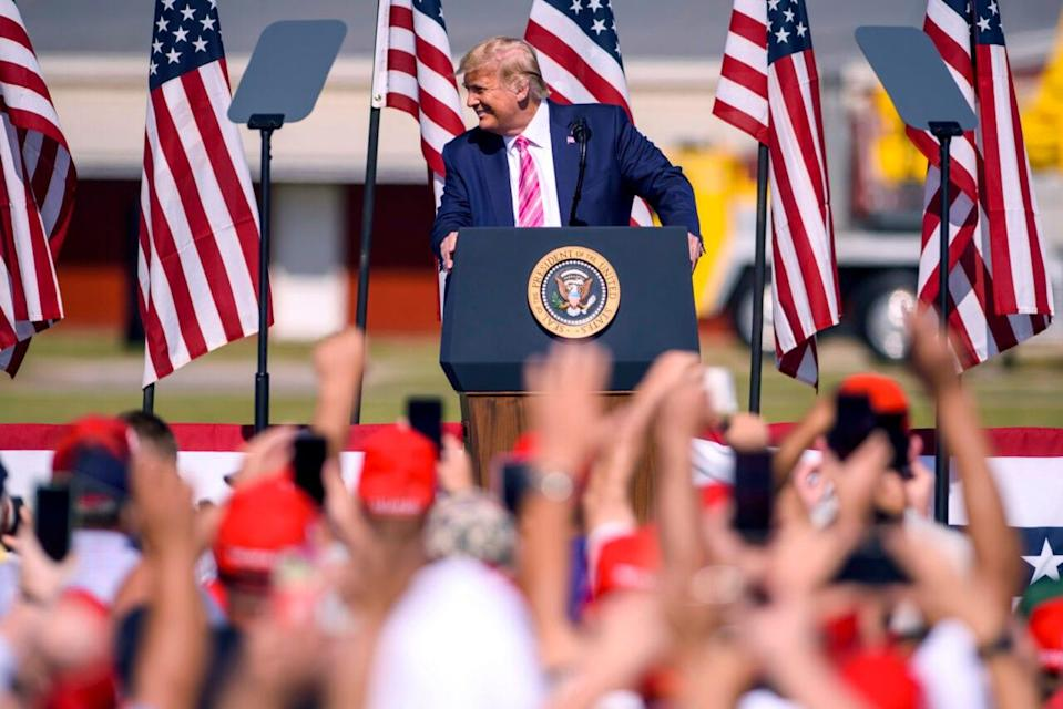 U.S. President Donald Trump addresses a crowd during a campaign rally on October 24, 2020 in Lumberton, North Carolina. (Photo by Melissa Sue Gerrits/Getty Images)
