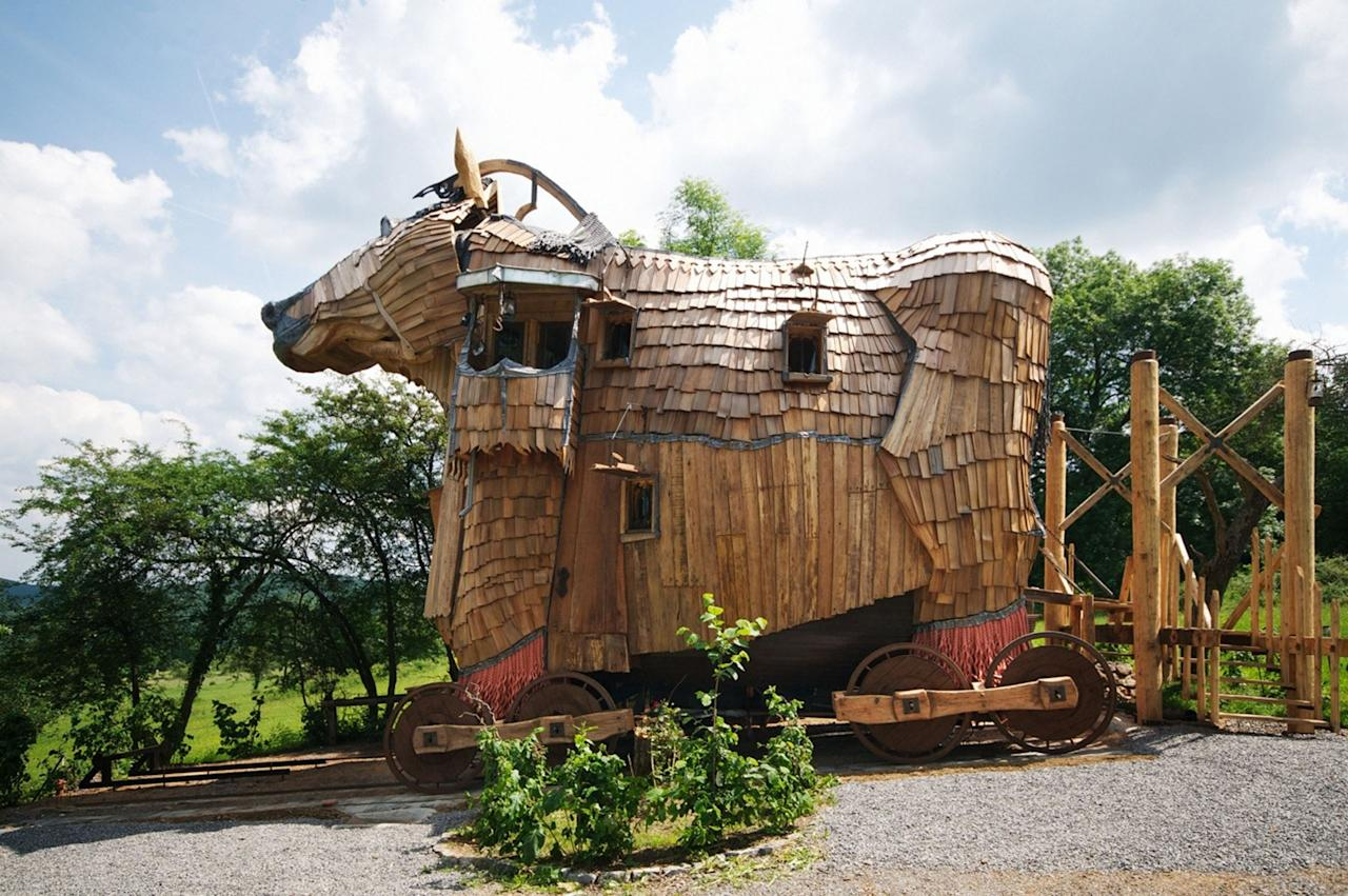 This structure is more Trojan hotel than Trojan horse. Inside is a luxurious hotel suite at La Balade Des Gnomes resort in Durbuy, Belgium. Guests can also choose to stay in a 'troll's habitat' with a babbling stream and goldfish (Caters)