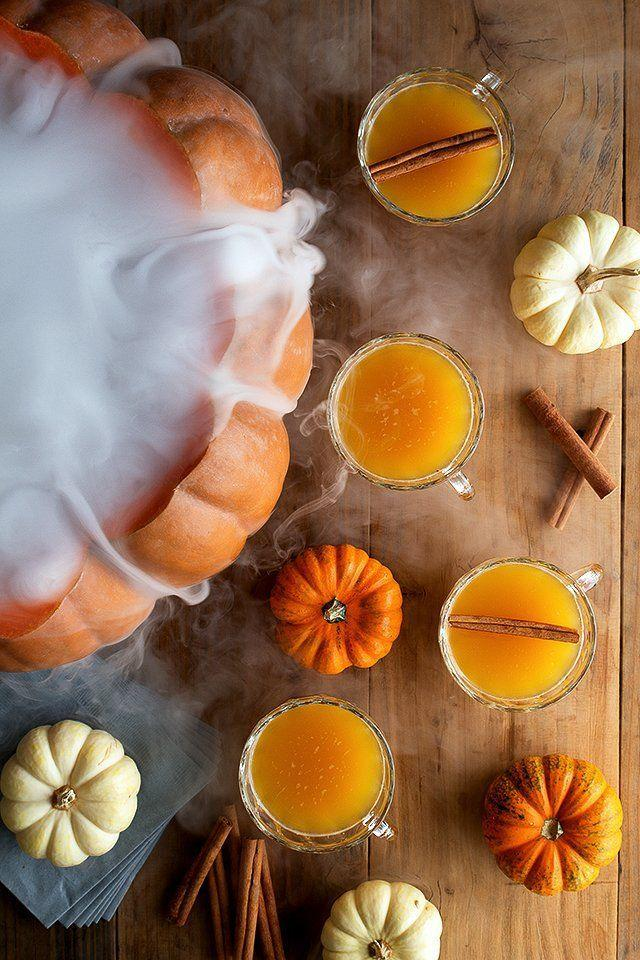 """<p>Combine 750 ml bottle of spiced rum, 1 cup of orange juice, 1 cup of lemon juice, 1 cup of spiced syrup (see below), 1/2 cup of pumpkin puree. Strain, and chill until you're ready to serve. Pour into your punchbowl, add 2 1/2 cups of sparkling water and cinnamon sticks for garnish.<br><br>For the spiced syrup: Add 6 whole cloves, 6 allspice berries, 1 cinnamon stick, 1 star anise pod, 6 white peppercorns, and 1/2 a nutmeg to a saucepan over medium heat. Add 1/2 cup of demerara sugar and 1/2 cup of water,stirring constantly to dissolve the sugar. Bring to a simmer and turn heat to low. After 10 minutes, remove from heat and strain. Cool to room temperature. </p><p><em> Recipe from <a href=""""https://honestlyyum.com/6804/halloween-pumpkin-punch/"""" rel=""""nofollow noopener"""" target=""""_blank"""" data-ylk=""""slk:Honestly Yum."""" class=""""link rapid-noclick-resp"""">Honestly Yum.</a></em></p>"""